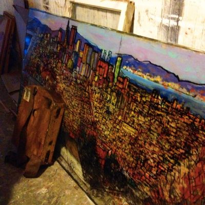 Artist Chris Duke's San Francisco skyline painted on a discarded window glass © Travelwithmk.com